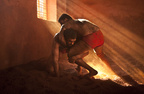 Wrestlers battle near a light beam.JPG