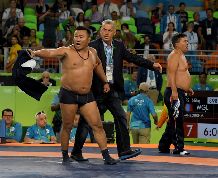 Mongolian Wrestling Coaches Strip Down in Protest at the Olympics